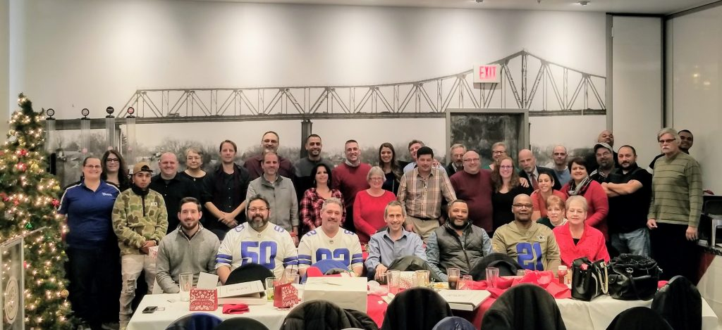 About Samson - photo of Samson employees at a holiday party